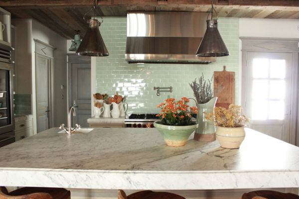 granite countertops and turquoise subway tile backsplash