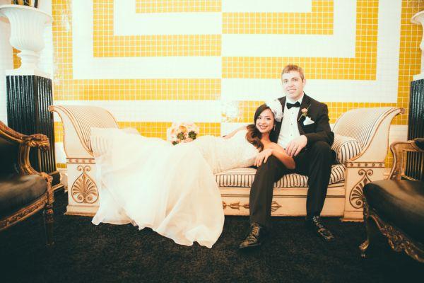 bride, groom, birdcage veil, mermaid dress, tuxedo, bow tie, bouquet, chaise lounge, tile, yellow, white