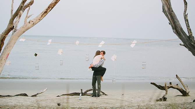 Mason Jar and Photograph Proposal on the Beach - Wedding Blog